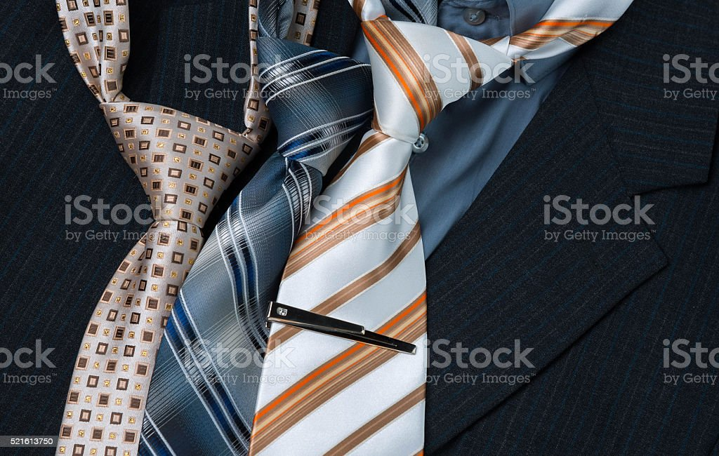 set of colorful men's ties isolated on dark background stock photo
