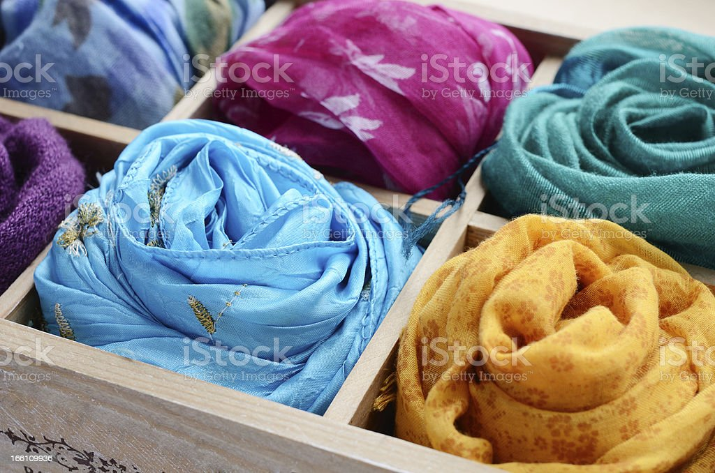 Set of colorful scarves in wooden box stock photo