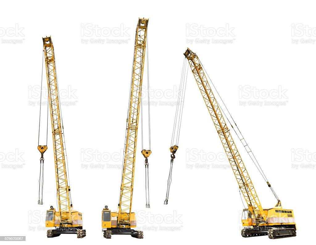 set of construction yellow crawler cranes isolated stock photo