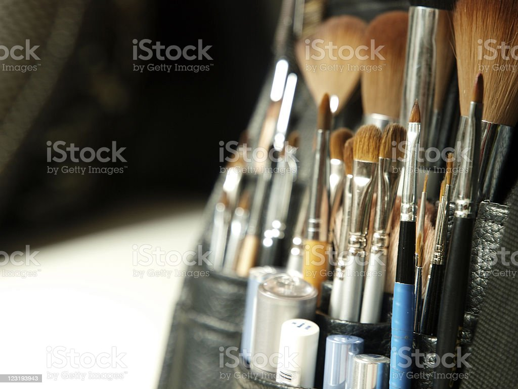 Set of cosmetic brushes in a black leather case stock photo