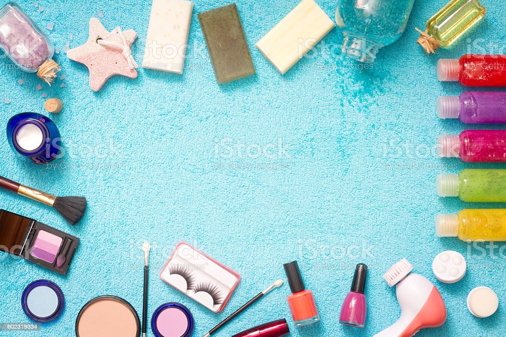 Set of cosmetics on blue towel stock photo