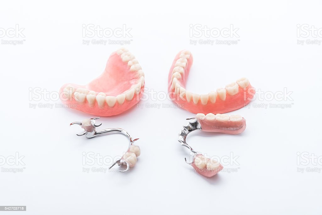 Set of dentures on white background stock photo