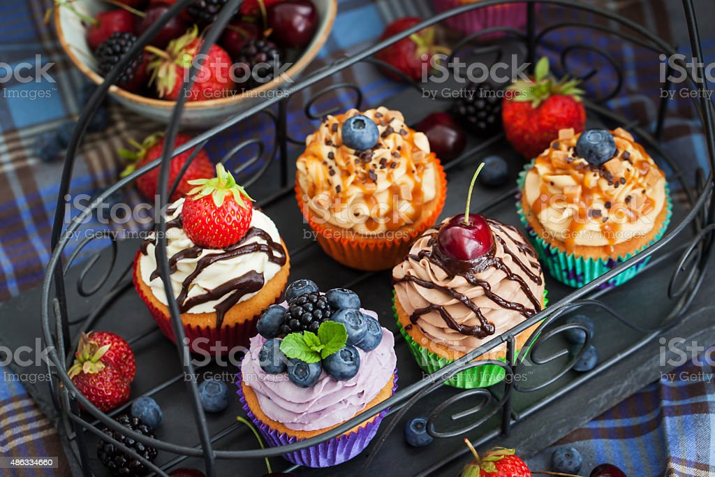 Set of different delicious cupcakes stock photo