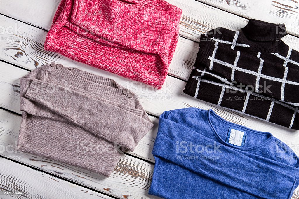 Set of different female pullovers. stock photo