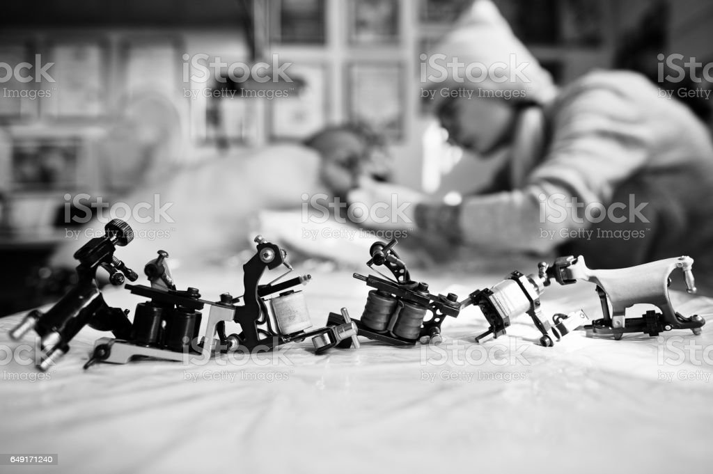 Set of different machines for tattoo background tattoo master at work. Black and white photo stock photo