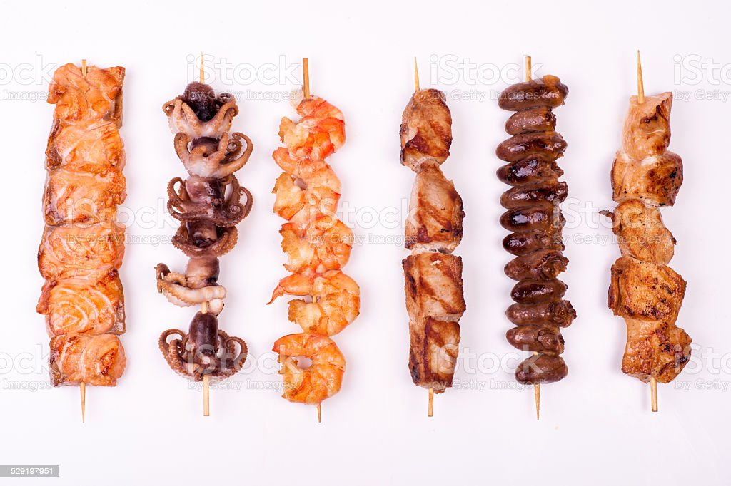 set of different meat skewers stock photo