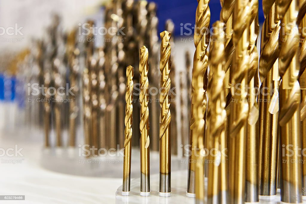 Set of drill bits for metal and wood in shop stock photo
