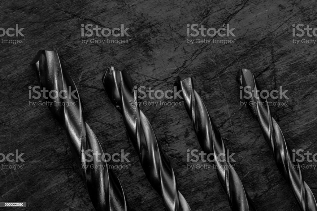 Set of drill bits on wooden background. Symbolic repair tool, bl stock photo