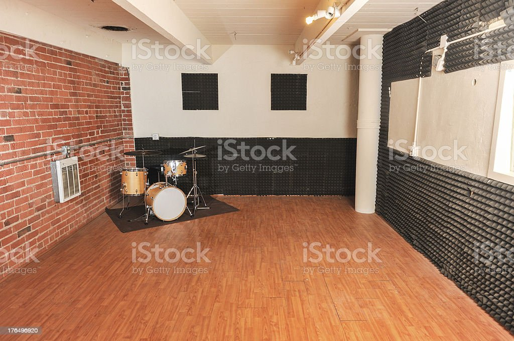 Set of drums in a brick and wood studio royalty-free stock photo