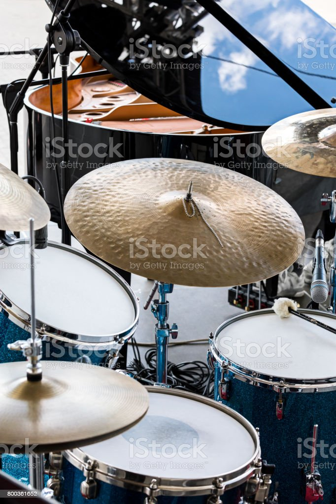 set of drums, microphones and wires on stage before performance of street drummers stock photo