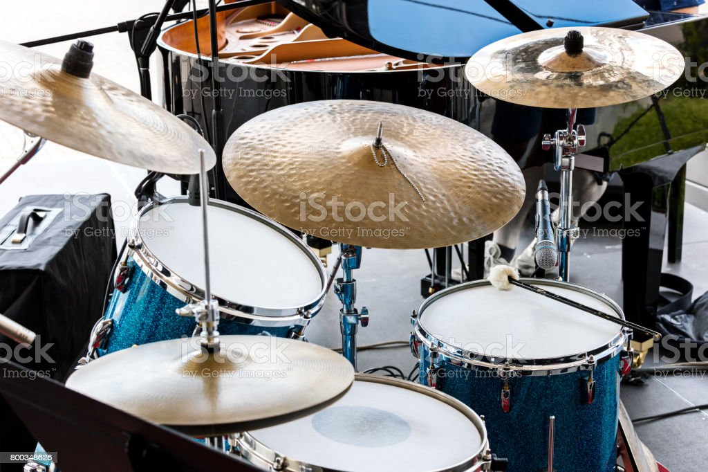 set of drums standing on outdoor stage before performance of drummers stock photo