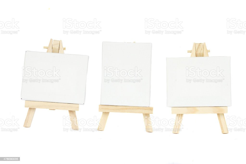 set of easels with blank canvas stock photo