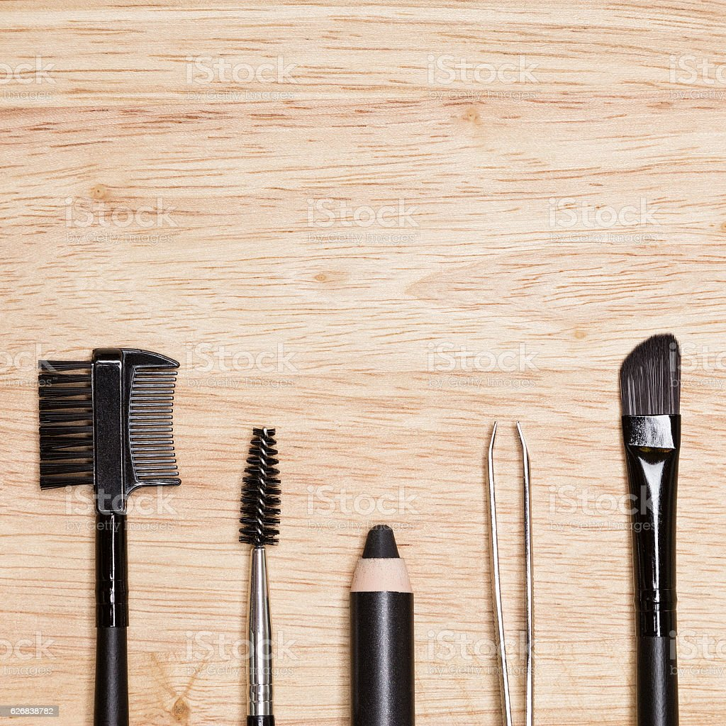 Set of eyebrow grooming tools with copy space stock photo