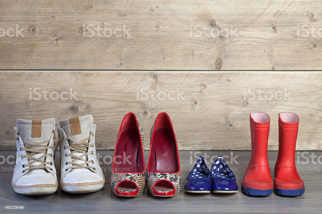 Set of familie shoes in line stock photo