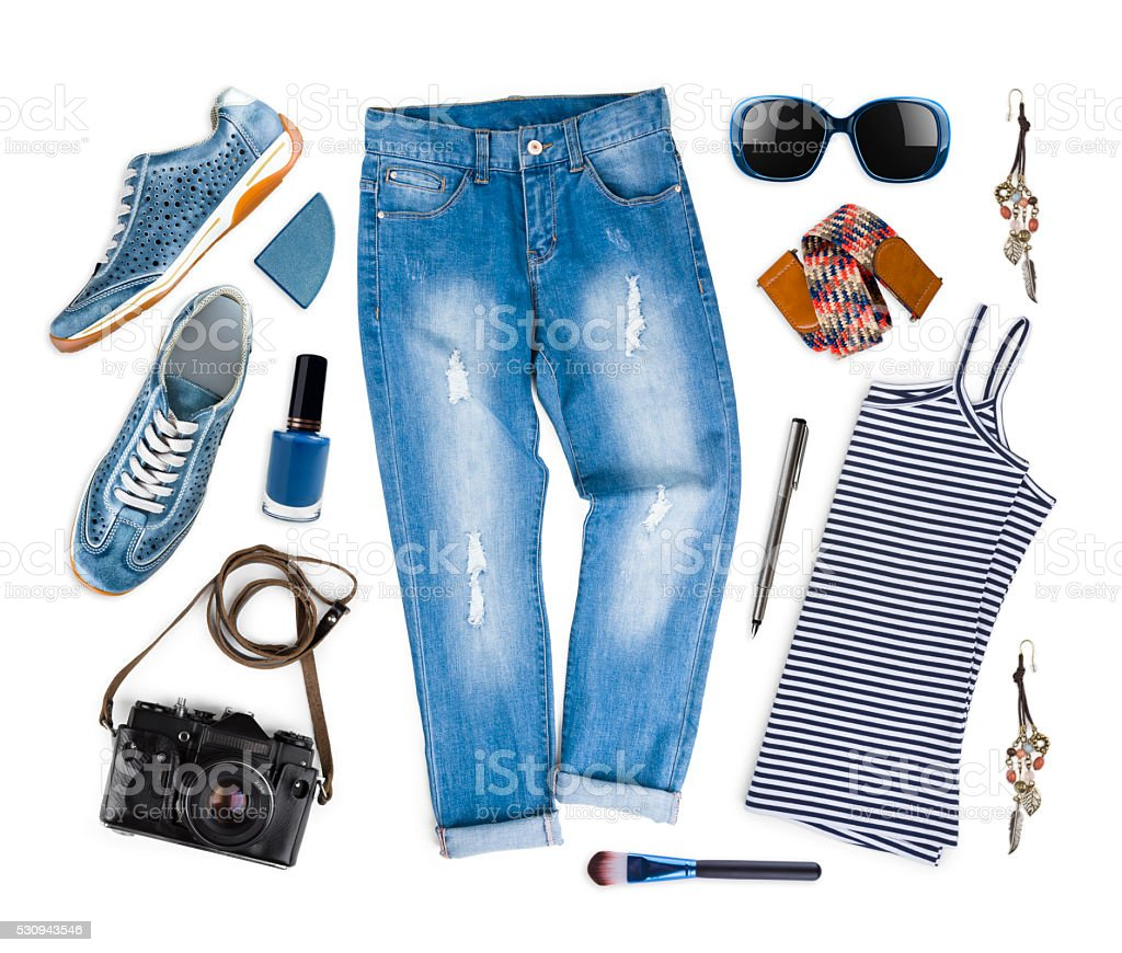 Set of female clothes and travel accessories isolated on white stock photo