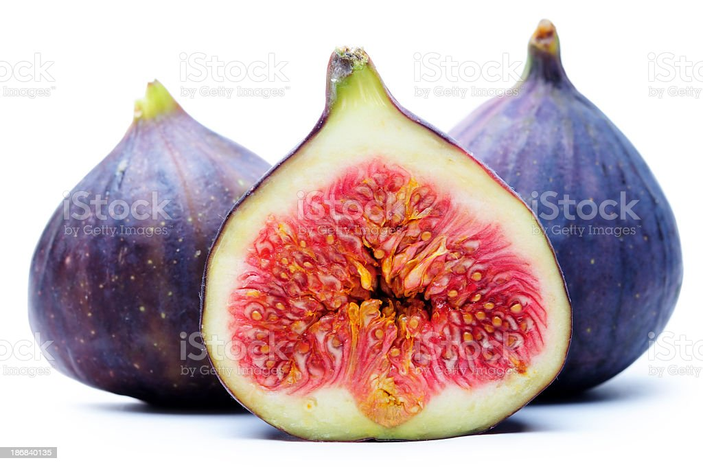 A set of figs one has been sliced stock photo