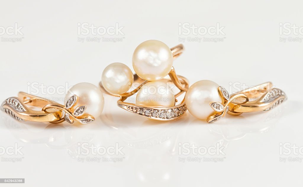 set of fine gold jewelry with pearls stock photo