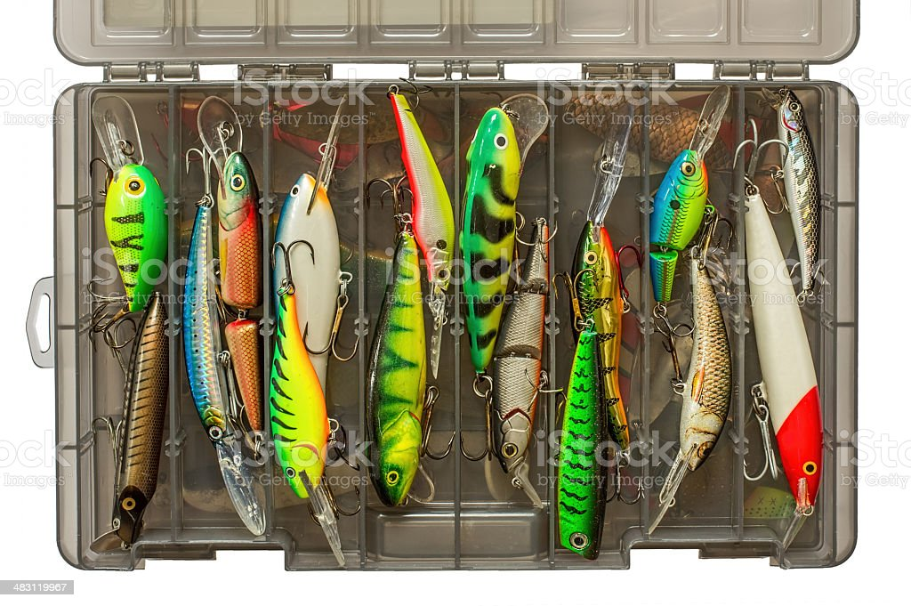 Set of fishing lures in box stock photo
