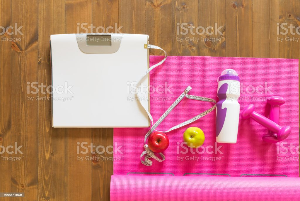 set of fitness and measuring the results of training on the board stock photo