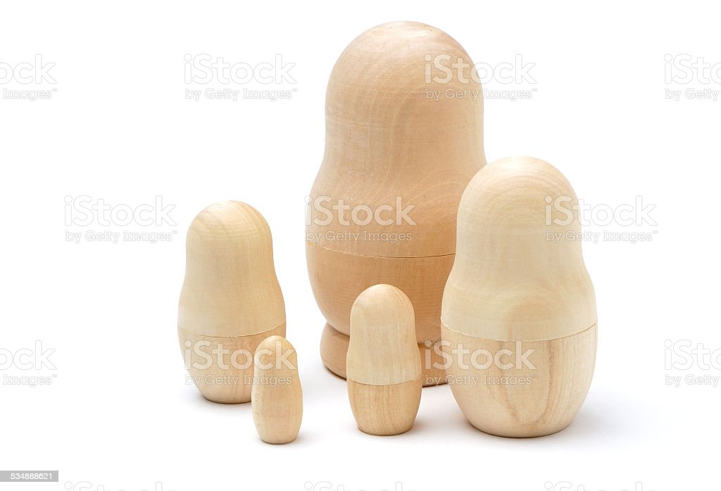 Set of five wooden unpainted matryoshkas stock photo