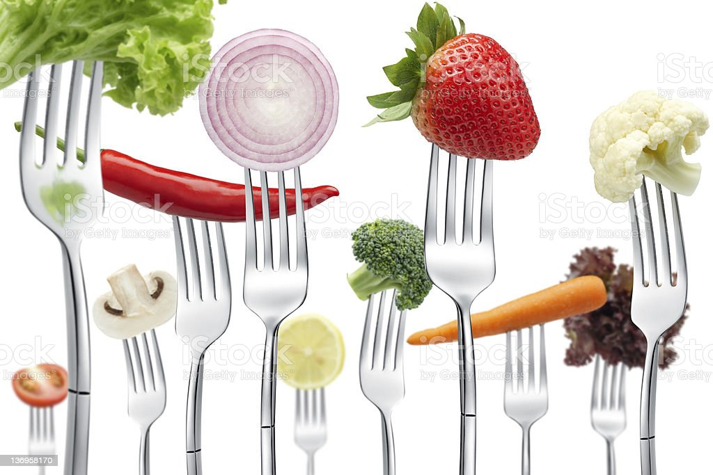 Set of forks each with a different vegetable royalty-free stock photo