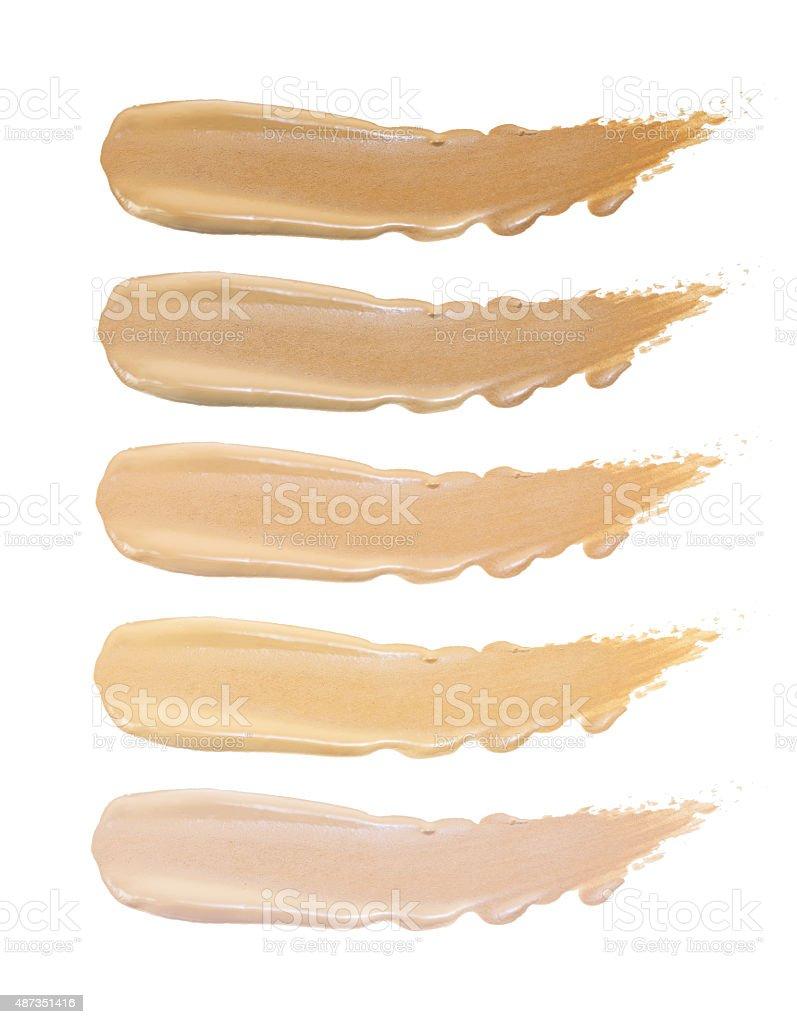 Set of foundation swatches isolated on white background stock photo