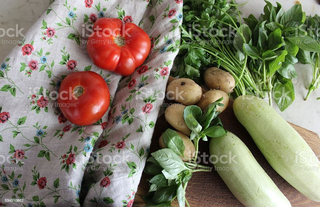 Set of fresh homestead vegetables and greens on the table stock photo
