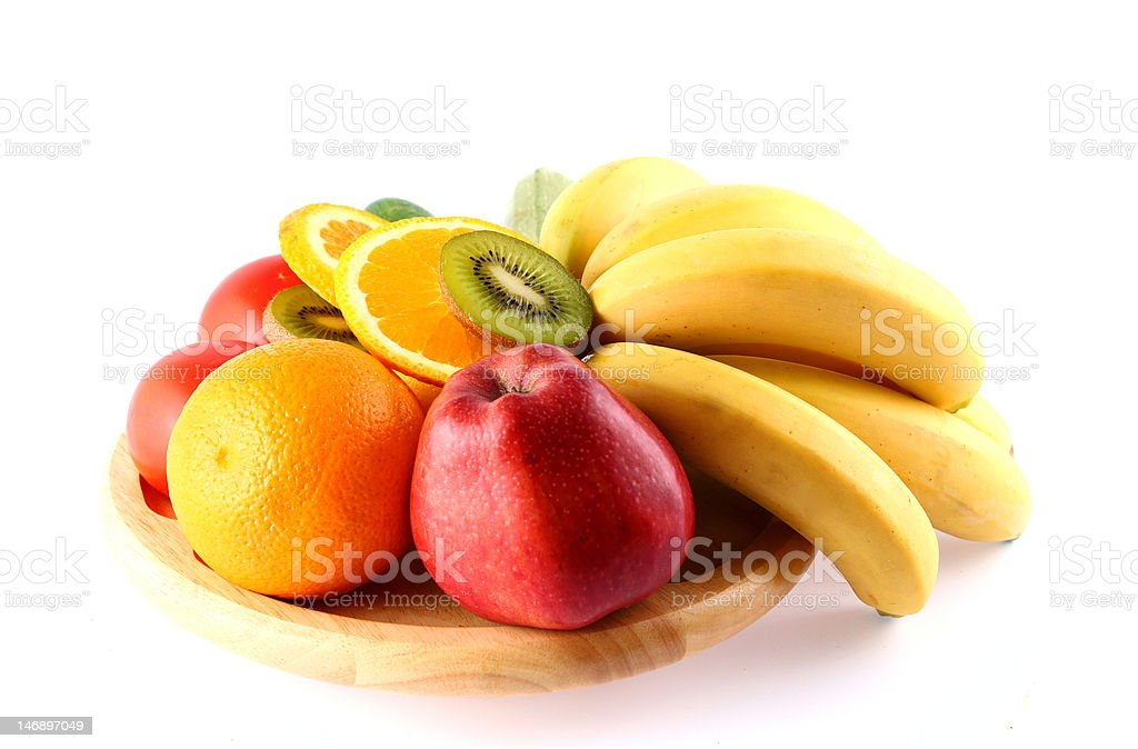 Set of fruits on wooden plate royalty-free stock photo