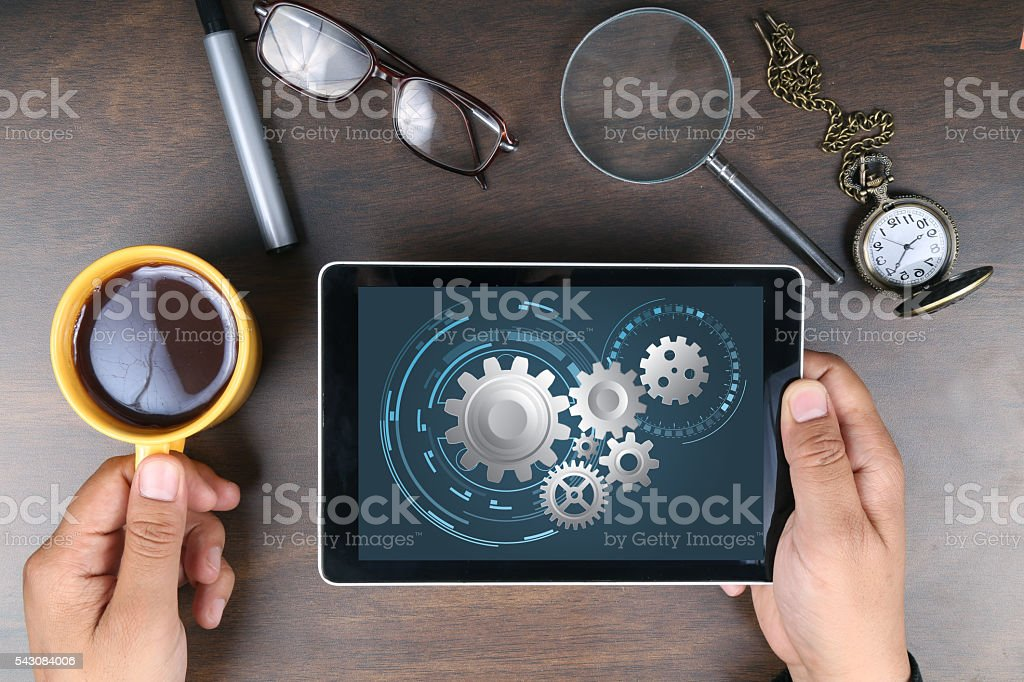 Set of gears on digital tablet stock photo
