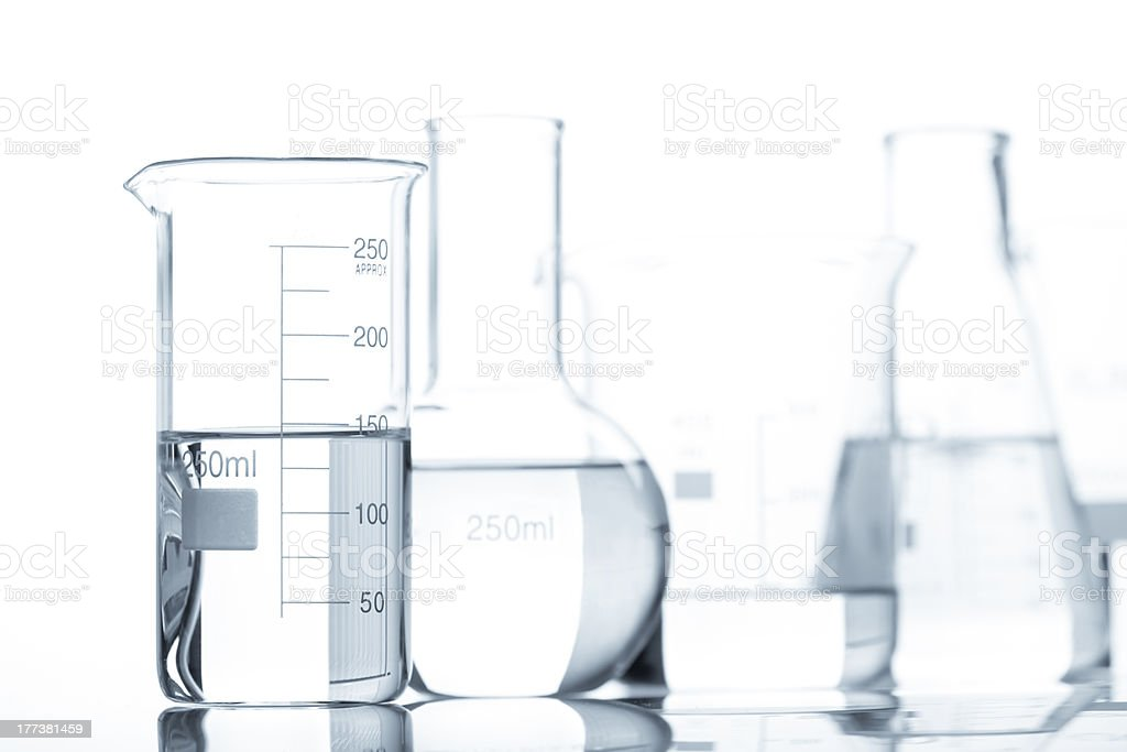 Set of glass flasks with a clear liquid stock photo