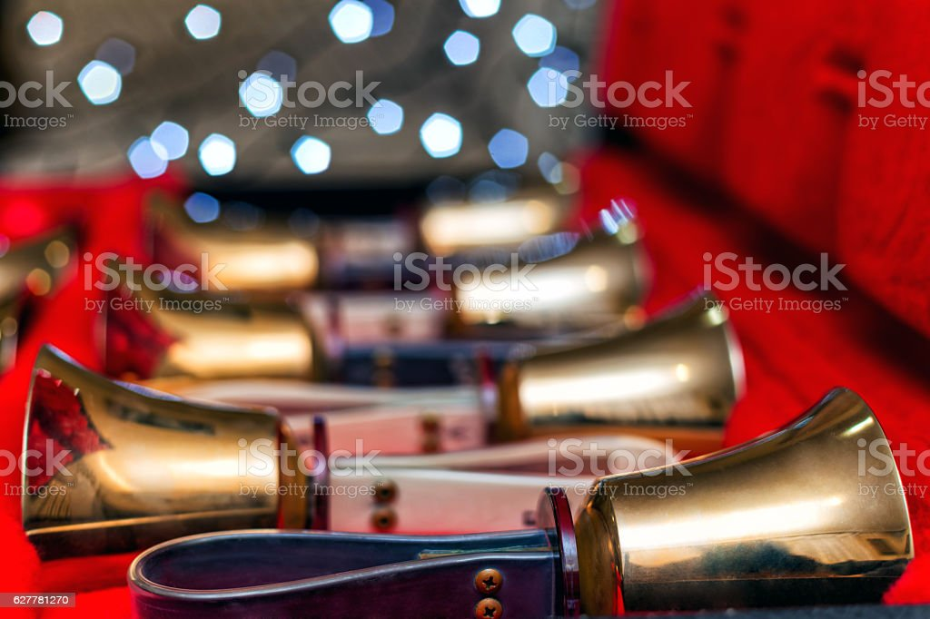Set of gold handbells on table during concert. Christmas time stock photo