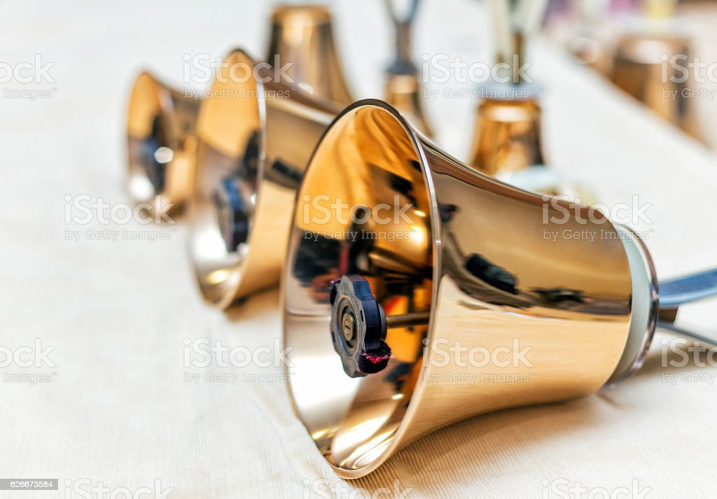 Set of gold handbells on table during concert stock photo