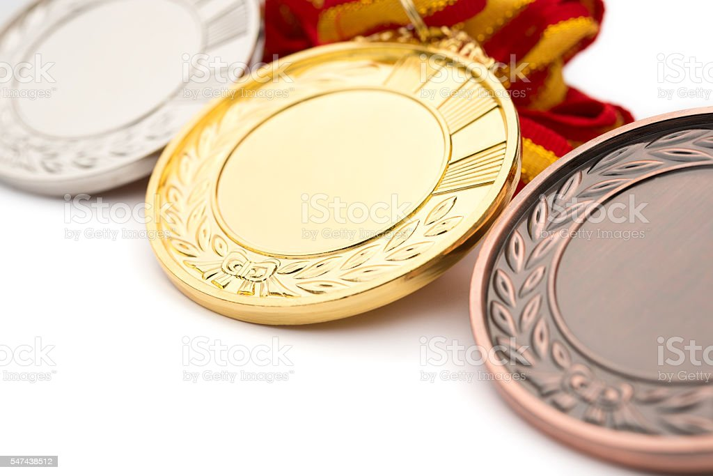 set of gold silver and bronze award medals on white stock photo
