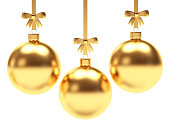 Set of golden Christmas balls with ribbons and bows