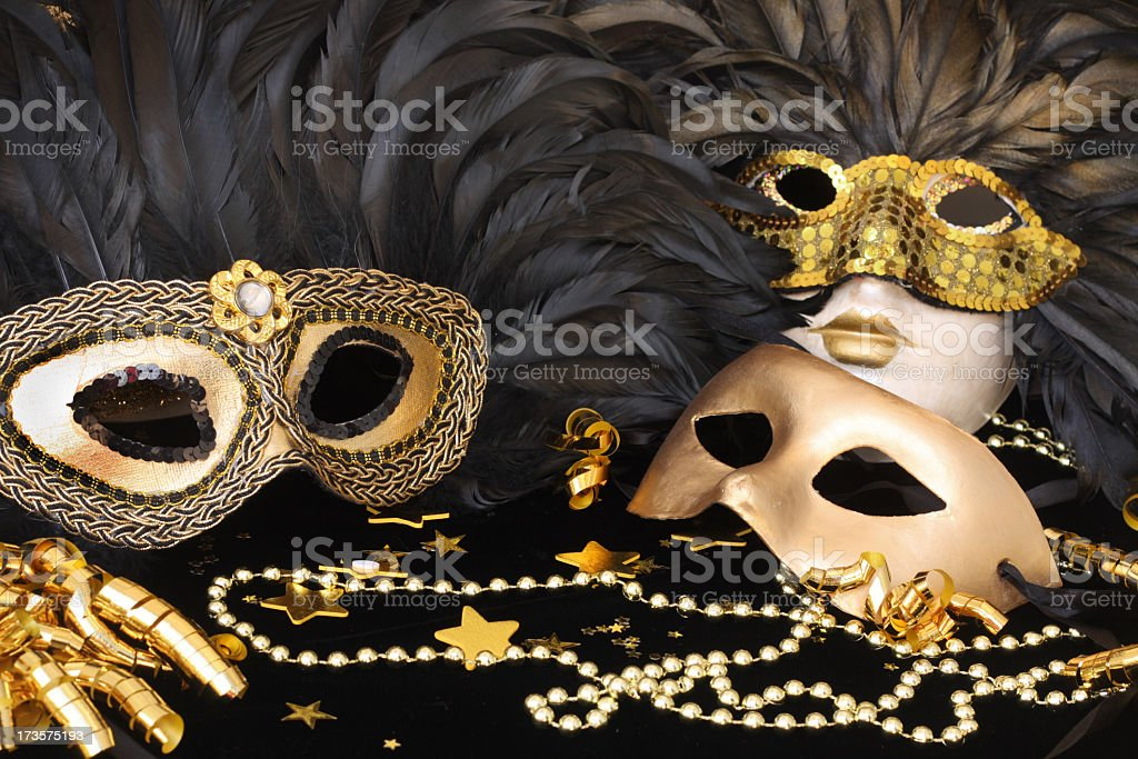 Set of golden mardi grass masks with feathers stock photo