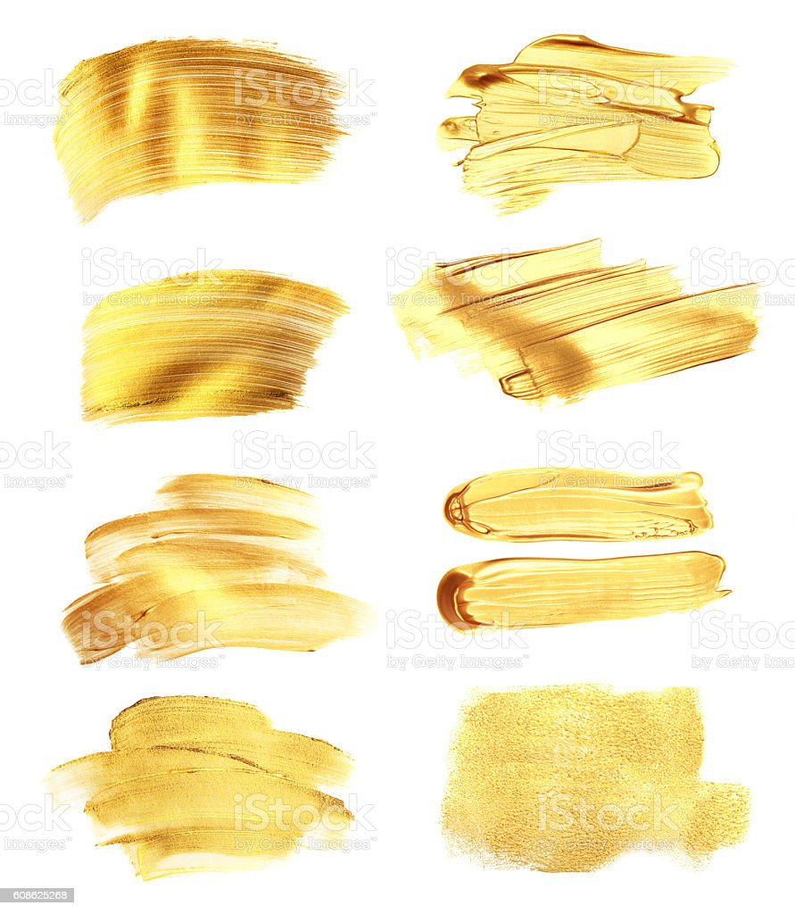 Set of golden paint strokes, isolated on white. stock photo