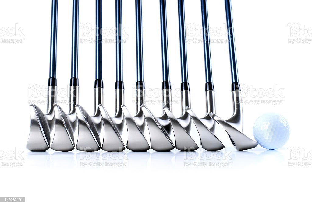 Set of golf club iron heads with a golf ball stock photo
