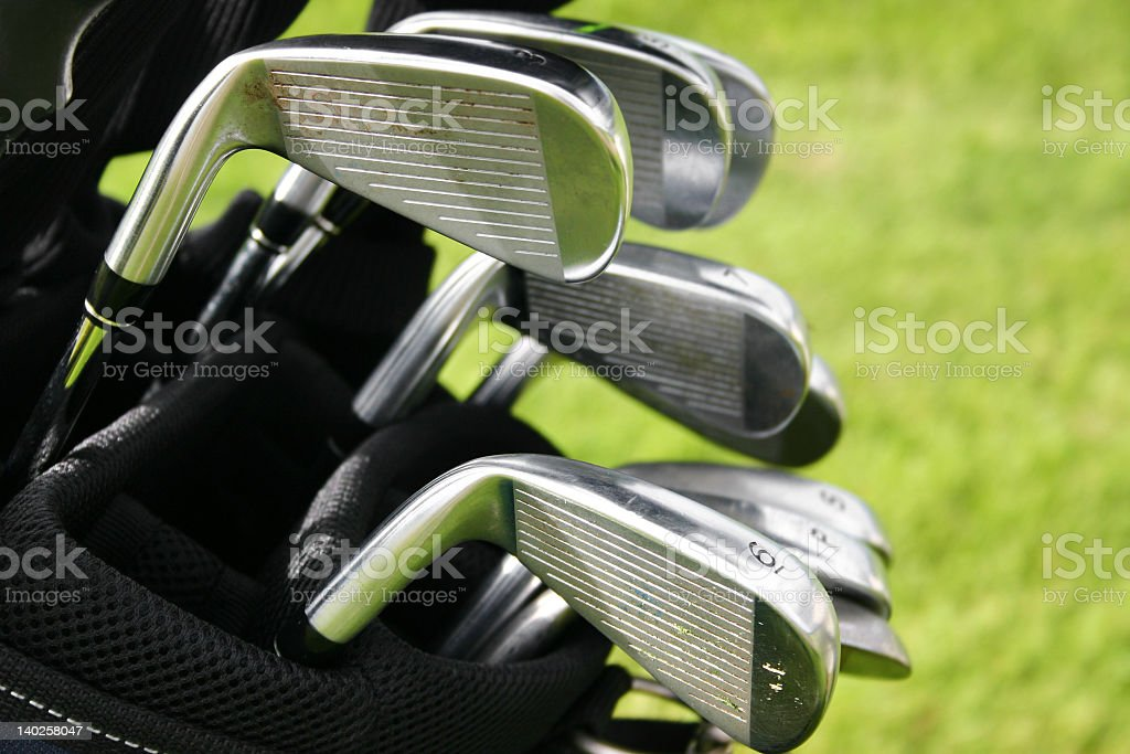 Set of golf clubs in a golf bag stock photo