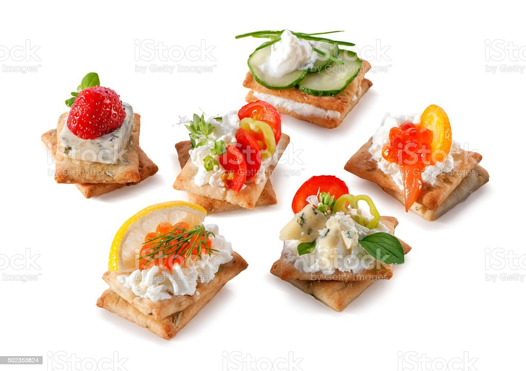 set of gourmet crackers snacks close-up isolated on white stock photo