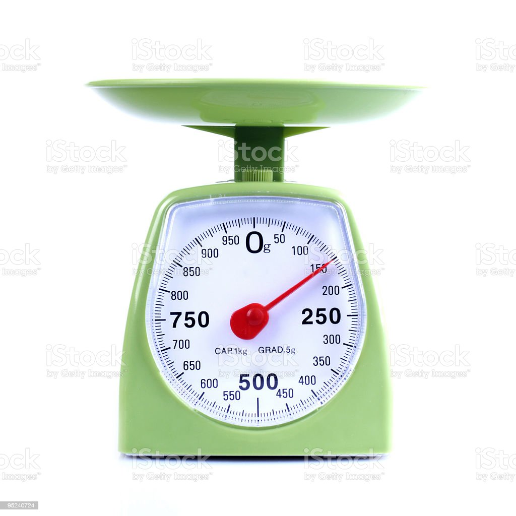 Set of green kitchen scales with red arrow pointing to 150 royalty-free stock photo