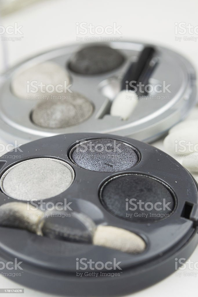 Set of grey eye shadow and applicator brushes royalty-free stock photo