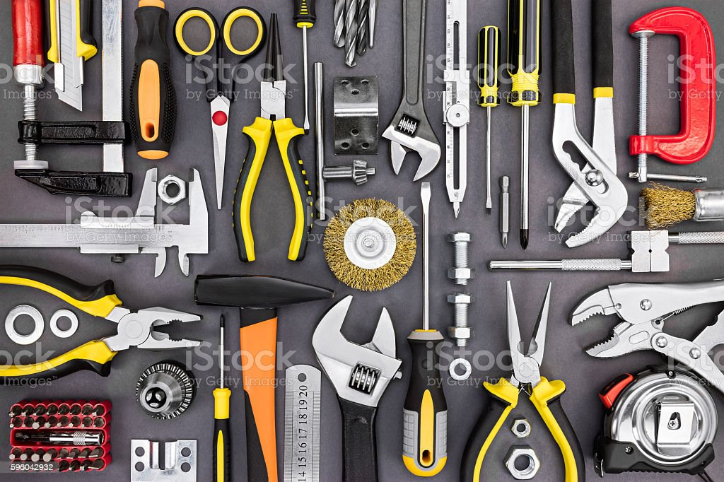 set of hand various work tools on grey background stock photo