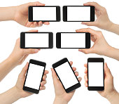 Set of hands holding smart phones isolated