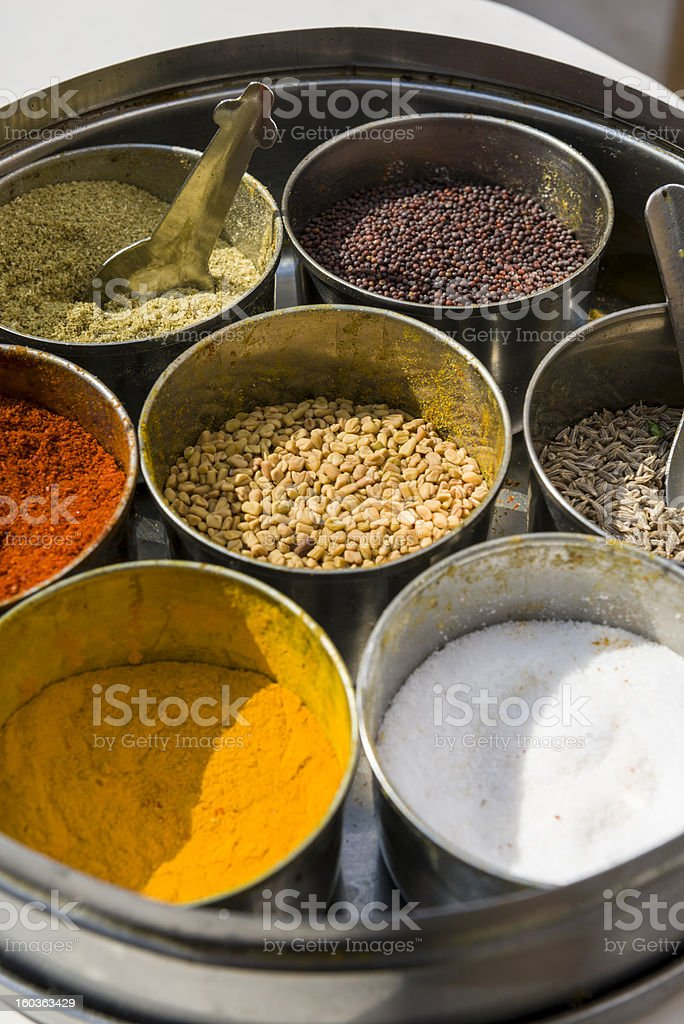 Set of Indian spices in metal bowls royalty-free stock photo