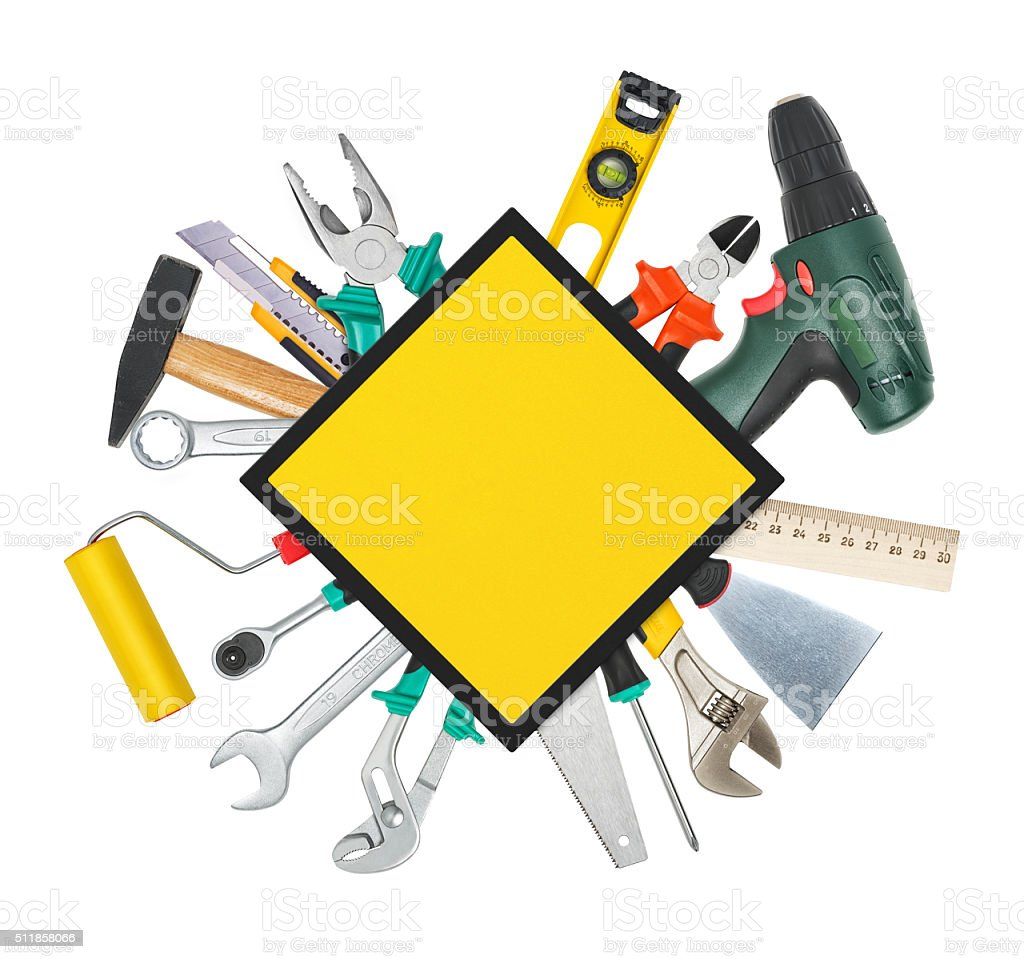Set of instruments and  tools underneath construction sign stock photo