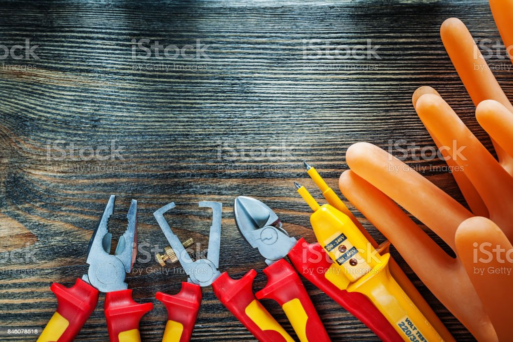 Set of insulating electric tools on wooden board stock photo