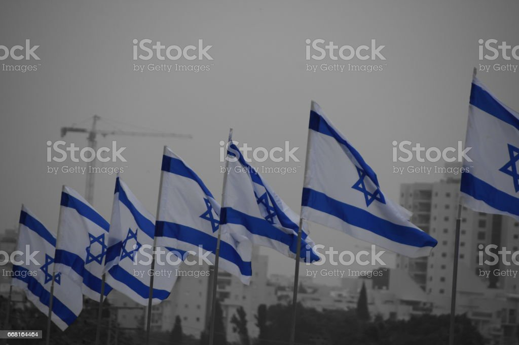 Set of Israeli  flags on a city background stock photo