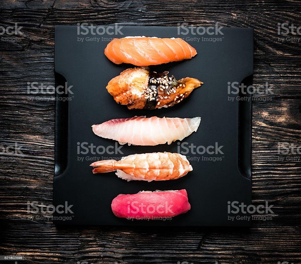 set of japanese sushi sashimi on black tray stock photo