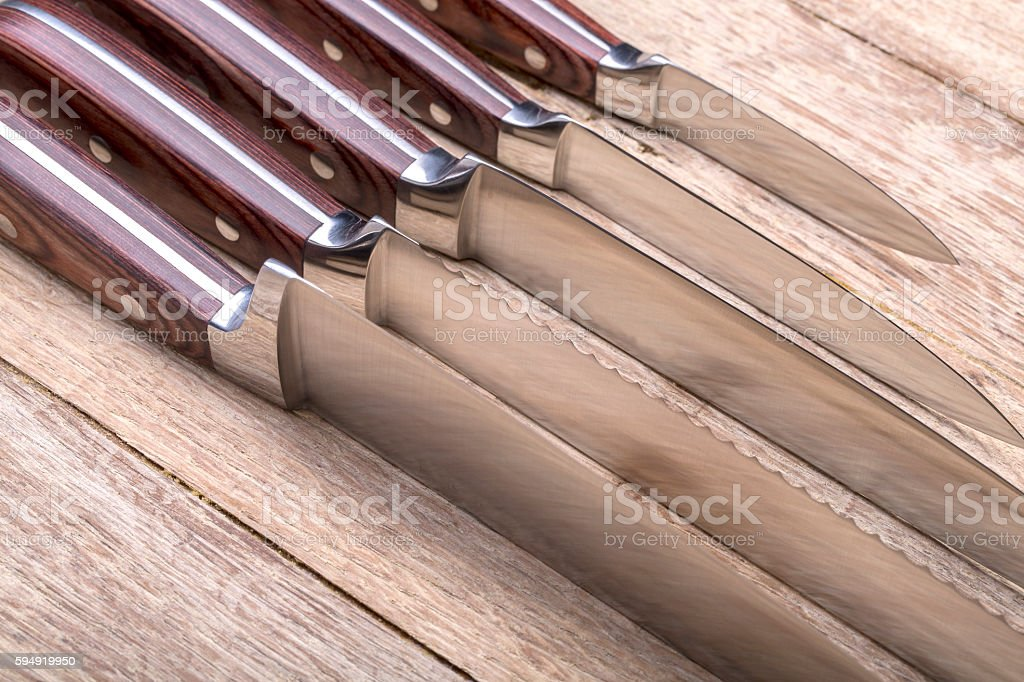 set of  knives on a cutting board stock photo