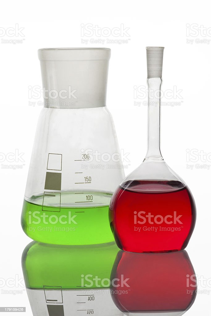 Set of laboratory glassware filled with multicolored liquids. royalty-free stock photo